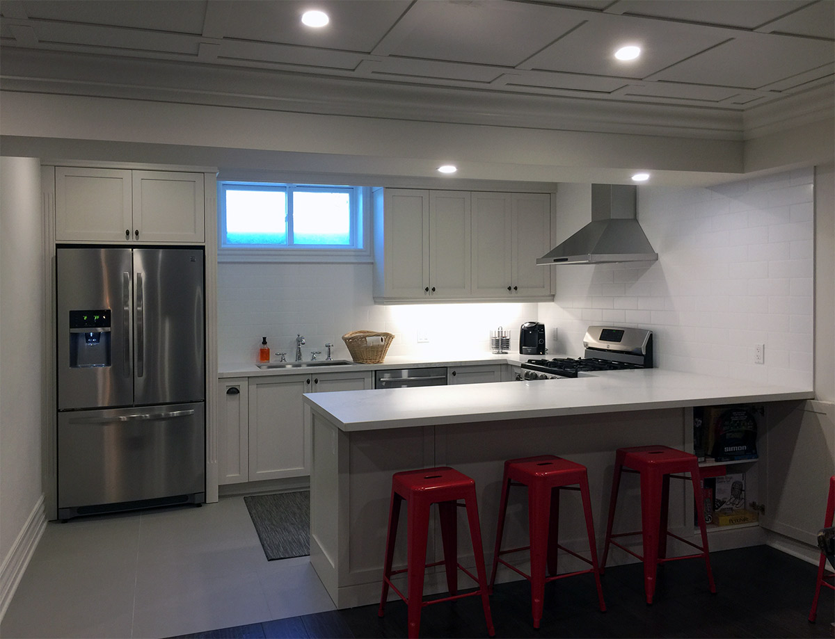 White kitchen and red stools